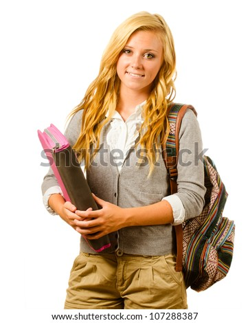 Portrait of happy smiling teenage schoolgirl with backpack and binder isolated on white - stock photo