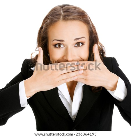 Portrait of happy smiling young business woman covering with hands her mouth, isolated against white background - stock photo