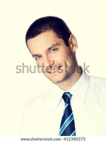 Portrait of happy smiling young businessman - stock photo
