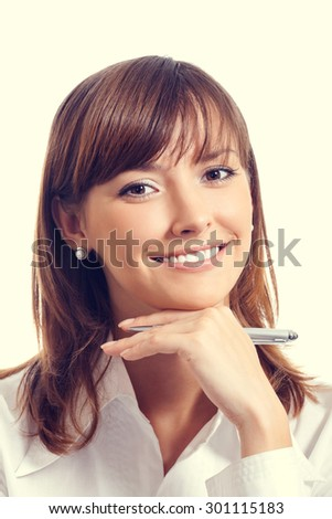 Portrait of happy smiling young businesswoman or student with pen - stock photo