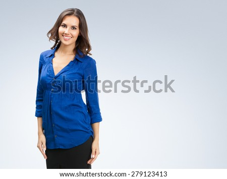 Portrait of happy smiling young businesswoman, with blank copyspace area for slogan or text - stock photo