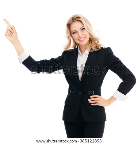 Portrait of happy smiling young cheerful businesswoman, showing something or blank copyspace area for slogan or text message, isolated against white background - stock photo