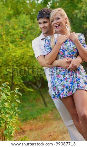 Portrait of happy smiling young couple - stock photo