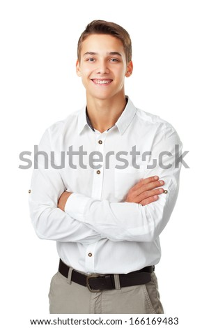 Portrait of happy smiling young man wearing a white shirt standing with hands folded against isolated on white background - stock photo