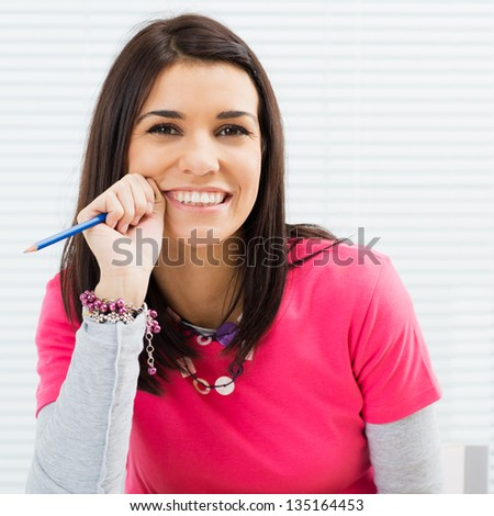 Portrait Of Happy Student Girl at College - stock photo