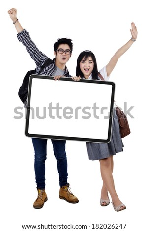 Portrait of happy students holding empty copy space. isolated on white background - stock photo