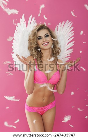 Portrait of happy sweet and sexy angel  - stock photo