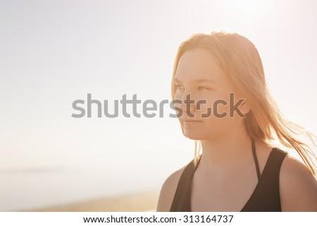 portrait of happy teen girl on beach, summe photo - stock photo