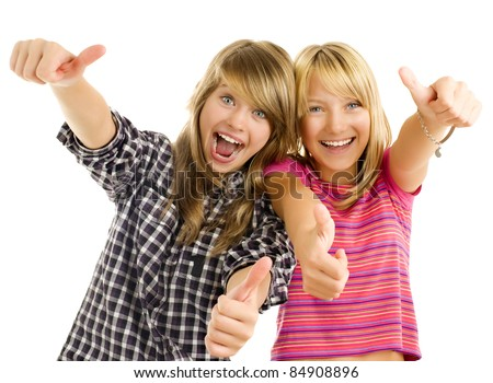 Portrait of happy teen girls showing thumbs up isolated one white - stock photo