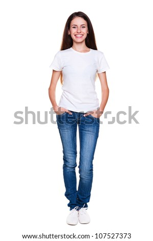 portrait of happy teenager in white t-shirt and jeans. isolated on white background - stock photo