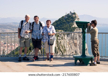 Portrait of happy tourist people on the Rock of Gibraltar. - stock photo