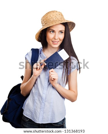 Portrait of happy tourist woman holding passport on holiday on white background - stock photo