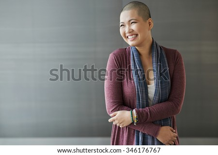 Portrait of happy Vietnamese breast cancer survivor - stock photo