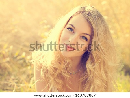 Portrait of Happy Woman at Summer Field - stock photo