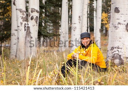 Portrait of Happy Woman in Autumn Forest - stock photo