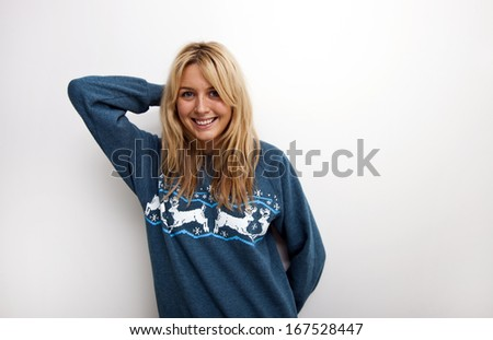 Portrait of happy woman in sweater against white background - stock photo