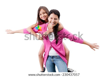 Portrait of happy woman piggybacking daughter against white background - stock photo