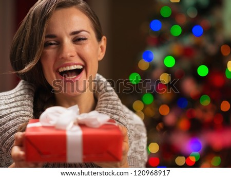 Portrait of happy woman with Christmas present box - stock photo