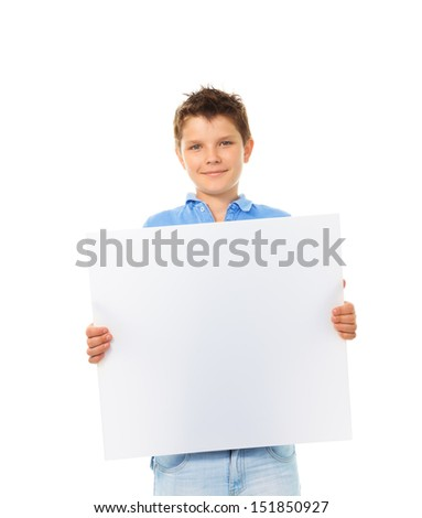 Portrait of happy young boy holding blank white sign plate - stock photo