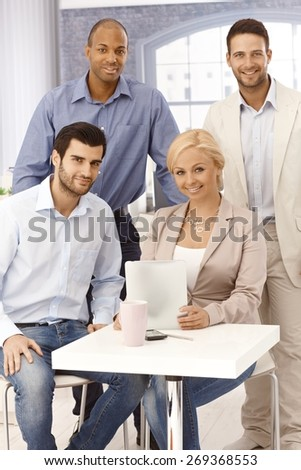 Portrait of happy young businesspeople, smiling, looking at camera. - stock photo