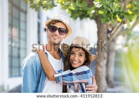 Portrait of happy young couple embracing each other - stock photo