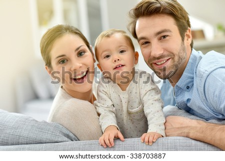 Portrait of happy young couple with baby girl  - stock photo