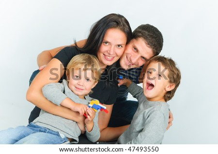 Portrait of happy young family with two sons - stock photo