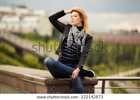 Portrait of happy young fashion woman outdoor - stock photo