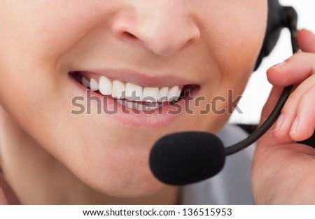 Portrait Of Happy Young Female Operator With Headphones - stock photo