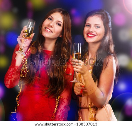 Portrait of happy young friends with cocktails - stock photo