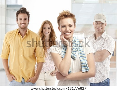 Portrait of happy young men and women, smiling, looking at camera. - stock photo