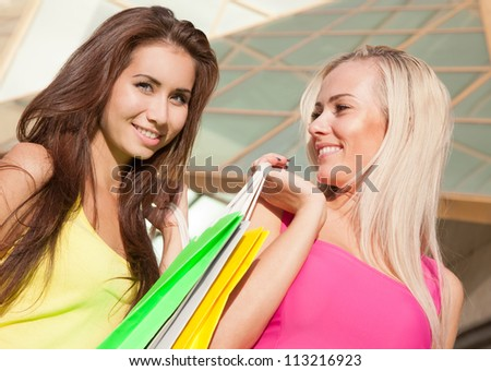 Portrait of happy young shopping together - stock photo