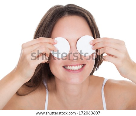 Portrait Of Happy Young Woman Cleaning Skin By Cotton Pad - stock photo
