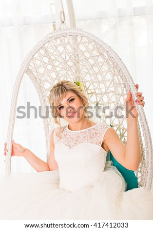 portrait of happy young woman in white wedding dress and bridal veil  - stock photo