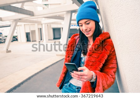 Portrait of happy young woman with smartphone - Fashion hipster girl using mobile smart phone in urban city area - Modern communications lifestyle and new technologies concept - Main focus on the face - stock photo