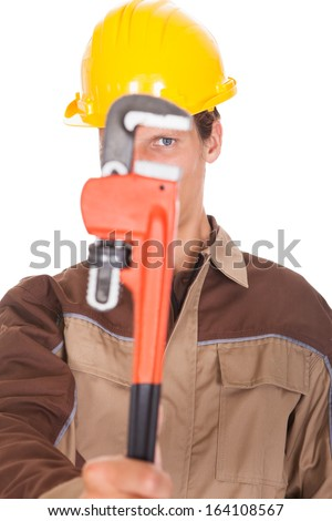 Portrait Of Happy Young Worker Wearing Yellow Hardhat On White Background - stock photo