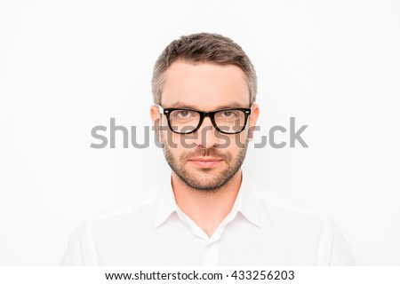 Portrait of hapy young smart businessman in glasses on white background - stock photo