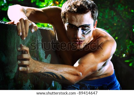 portrait of hard military handsome male model, outdoor shot - stock photo