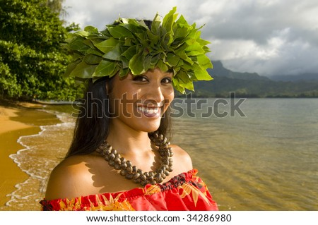 portrait of Hawaiian teenage girl smiling on the beach - stock photo