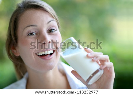 Portrait of healthy girl drinking milk - stock photo