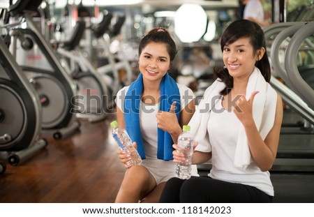 Portrait of healthy young woman promoting active lifestyle - stock photo