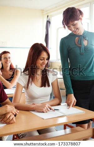 portrait of high school students discuss with teacher during the class  - stock photo
