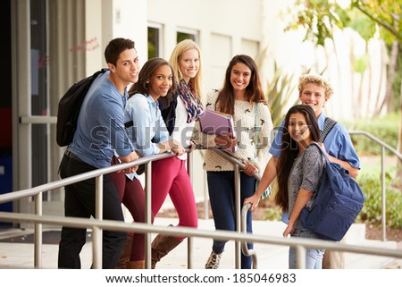 Portrait Of High School Students Standing Outside Building - stock photo