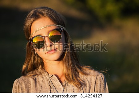 portrait of  hippie girl in sunglasses - stock photo