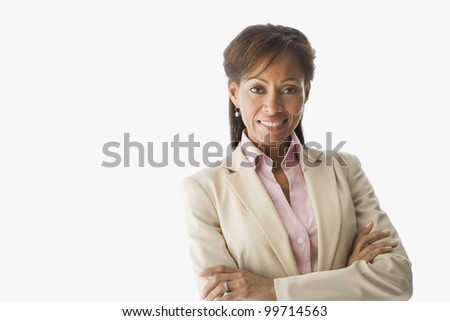 Portrait of Hispanic woman with arms crossed - stock photo
