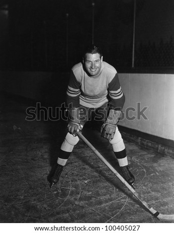 Portrait of hockey player - stock photo