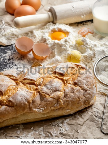 portrait of homemade rustice bread with ingredients - stock photo