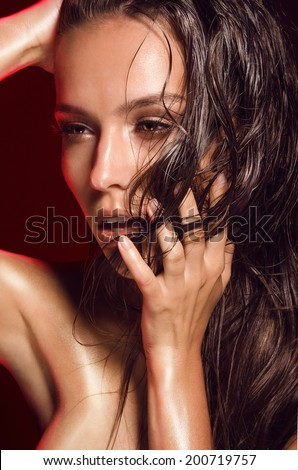 portrait of hot girls with dark hair, tanned shiny skin, wet, in oil, burning sun - stock photo