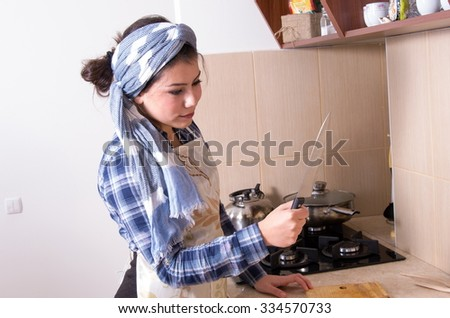 portrait of housewife in the kitchen - stock photo