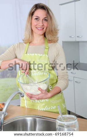 Portrait of housewife preparing meal - stock photo